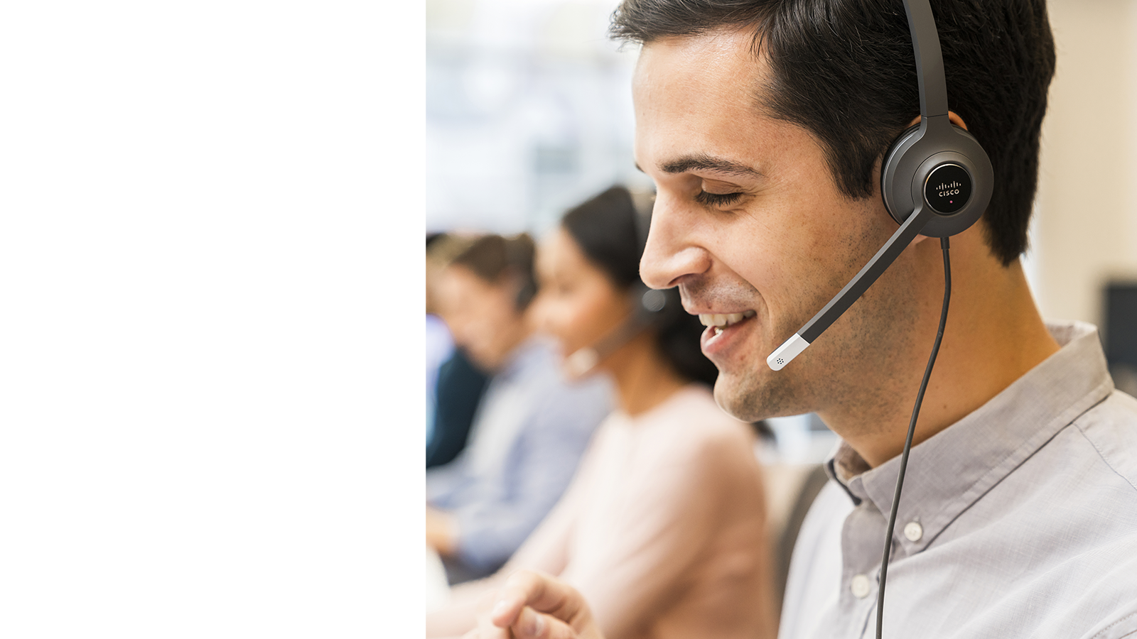 Male contact center operator talking on a Cisco headset